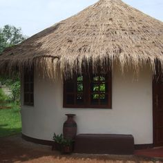 How to Build an Earthbag Roundhouse: Basic project information: 18' exterior diameter; 15' interior diameter; 177 sq. ft. interior floor space; total cost of materials: $2,045, which is about $11.50/square foot