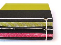 """IONA BINDING - Small handmade notebook that measures 7,08"""" x 4,01"""". Covered with black fabric and fluor paper."""