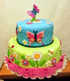 Colorful Birthday Cake with Butterflies and Flowers