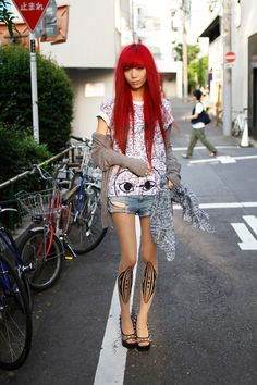 Japanese street style. Harakuku, long red hair, blunt bangs, patterned rights