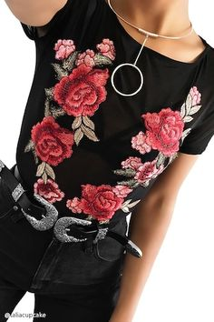 bc578cfafc6bc2 A sheer mesh knit bodysuit featuring a rose applique embroidery along the  front