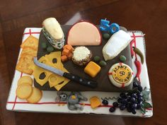 cheese board 50th birthday cake.Everything made with cake and fondant and all eatable