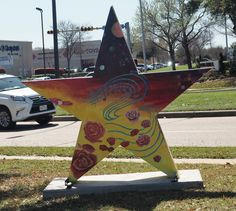 """Thousands of motorists catch a glimpse of this star by artist Linh Ngueyen (and Arlington school children). It's located at 1111 W. Arbrook Boulevard outside the AISD Training Center across the street from the Parks of Arlington Mall. The work is titled """"Education."""""""