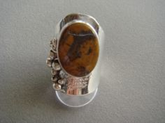Silver ring with picture tiger eye