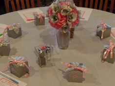 We created the vase and the favor boxes for my sisters wedding.