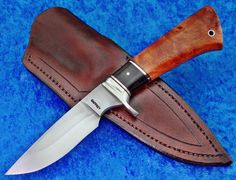 Deferentially Heat Treated 1084 Blade, Fluted Nickel Silver guard, Copper/African Blackwood spacers, Amboynia Burl handle.