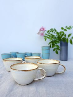 This creamy white mug, designed especially for cappuccino. If you have a coffee machine at home, Its the perfect mug to use! Its a rather short mug