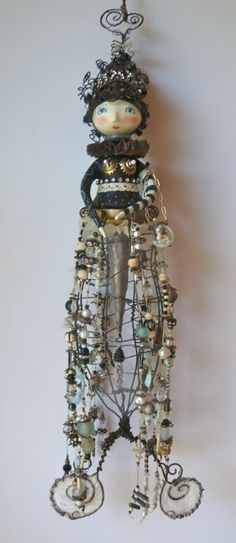 Captain Nemo's Lover, Julie Haymaker Thompson Wire, paper clay, beads, wood.