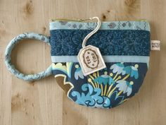 Teacup Pouch by PatchworkPottery on flickr-- i really need to make one of my own! xD