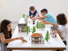 Cardkits are paper toys made with card stock that children assemble themselves, and can then use to build their own miniature cities. Paper Toys Making, Kids Punch, Paper Furniture, Blue Shutters, Colorful Fish, Creative Play, Furniture Arrangement, Building Toys, Family Activities