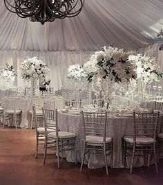 Elegant reception setup with white flowers and silver decor | photo by Amy Bennett Photography