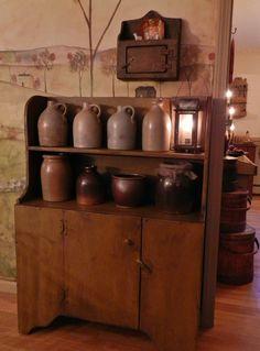 Primitive Cupboard...filled with old salt glazed crocks.