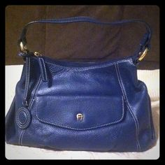 """NWOT Superior Pebble Grain Leather Mini Bag Superior Pebble Grain Leather Mini Bag. 1 Front Pocket. 1 zip inside pocket, 2 slip in pockets. Top Zip Closure. Gorgeous Rich Navy Blue in color with Gold Hardware & contrast stitching. Approx 10""""x6""""x3"""". 10"""" handle drop. Brand New! Never Worn! Etienne Aigner Bags Mini Bags"""