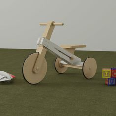 Tricycle for kids made in lacquered wood and varnished wood with matte finishing