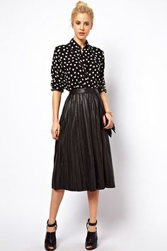 """I love a leather skirt. They are always stylish year in, and year out. It's a worthwhile investment piece, and this one is a great price.""  ASOS MIDI SKIRT IN PLEATED LEATHER, $202.51, AVAILABLE AT ASOS."