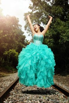 Quinceanera/ Sweet 15 photo shoot.  Fun and untraditional pose. www.norafrakerphotography.com