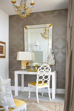 Surprisingly, the taupe damask wallpaper works really well with white and a pop of yellow.