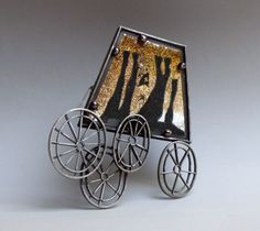 Jana Machatova  Brooch: ...he is beeing carred... 2012  Silver, paper in lamineted plastic, gold foil, pearls