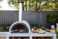 Backyard entertaining area pizza ovens 57 Ideas for 2019 Best Outdoor Pizza Oven, Outdoor Barbeque, Outdoor Oven, Backyard Patio, Backyard Landscaping, Outdoor Fireplace Designs, Four A Pizza, Exterior, Better Homes And Gardens
