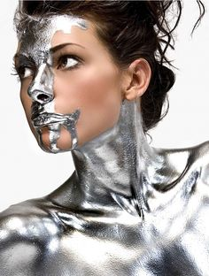 Metallic model dripping in liquid silver. #inspo