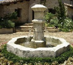 Stone is always in style. This carved stone fountain in the French courtyard look has a big enough basin to catch the splashes. From Fountains Unique. For more fountain insights visit http://www.landscapingnetwork.com/industry-leaders/bill-rose-fountains-unique.html