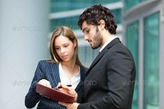 Business partners ... <p>Portrait of a business partners</p> advice, agenda, business, business people, businessman, businesswoman, city, company, corporate, date, discussing, employees, enterprise, entrepreneur, executive, job, man, management, manager, meeting, office, outdoor, partners, people, planning, smiling, talking, urban, woman, work, young