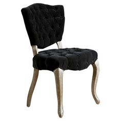 Perfect pulled up to your dining table or writing desk, this elegant side chair showcases tufted velvet-inspired upholstery and carved cabriole front legs.  ...