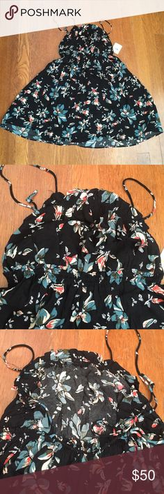 NWT Free People Hawaiian print dress A black dress with Hawaiian flowers. It is size small from Free People. NWT. It is spaghetti strapped and they cross and tie in the back. It is slightly sheer and short on me (I'm 5'5). Could fit an XS/S. Free People Dresses Mini