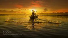 socialfoto:  Fisherman Hunter in the river by BoyBiew...