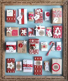 Advent Calendars - love this colour scheme, Scandi red and white with a turquoise accent - perfect for my living room (but I want to do it on a canvas with toilet rolls pillow boxes)