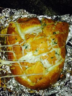 Take a loaf of Italian bread... Cut the bread horizontally and vertically to make the squares ... Load it up with garlic, butter, cheese (any type of chews you desire ) parsley ... Dress it up as you like ... Wrap in aluminum foil stick in the oven on 350 for 15-20 minutes and Walahh!!! Your very own pull apart garlic bread
