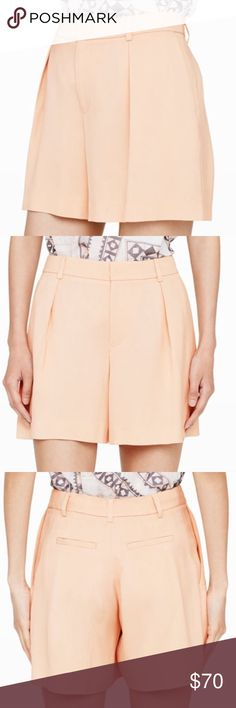 """Seena Shorts Luxe to the touch, the Seena shorts are the epitome of the laidback but polished look. Viscose. Pleated front. Seam details at back. Relaxed fit. Belt loops at waistband. Zip fly with hook-and-bar closure. Slash pockets at sides. Welt pockets at back. 5"""" inseam. Dry clean. Imported. Club Monaco Shorts"""