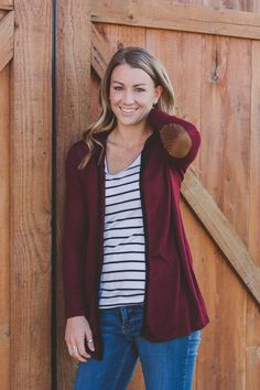 We are so in love with this darling hooded fall cardigan.  It is nice and thin and perfect for cool fall days.  The hood and the suede elbow patches are the perfect details.      Sizing:      Small 0-4    Medium 6-8    Large 10-12    *Model is wearing a small.    Materials:  87% Polyester, 10% rayon, 3% spandex    Length on Medium:  28 inches.   | Shop this product here: http://spreesy.com/pinkpineappleclothingcompany/165 | Shop all of our products at…