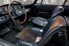 Stored in a barn for decades, the 911's interior is still in good condition. The driver's seat was replaced with an unrestored, vintage buck...