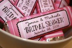 Shower favors? I could design/print the wrapper, then we buy some candy bars in bulk and voila. I think we could do this relatively inexpensively, and use a few different patterns of pink and orange.