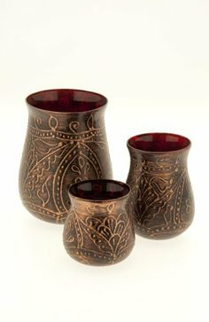"""UNICEF Batik Inspired Tea Light Holders by UNICEF. $3.99. Three hand-painted glass tea light holders with an intricate, embossed design and ruby red interior.  Tea light candles not included.  Made in India.  5 7/8"""", 4 1/2"""" and 3 1/4"""" tall."""