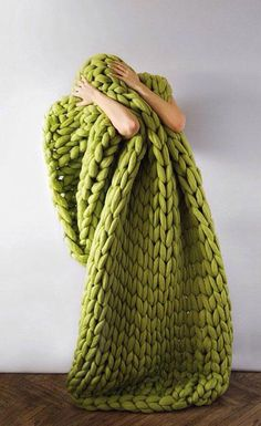 Ukraine-based designer Anna Mo creates the wooliest, comfiest-looking knit creations using super chunky, Australian merino wool yarn and 40 millimeter knitting needles.