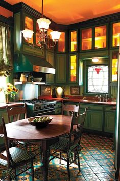 Victorian kitchen. I would paint a brighter color for the cabinets than that dark green