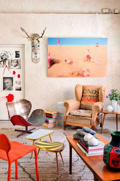 Antlers on skateboard, wooden chair, painting. Another room that I love.