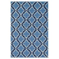 Anchor the living room or define a space in your master suite with this artfully hand-hooked rug, showcasing a quatrefoil motif in navy and blue.