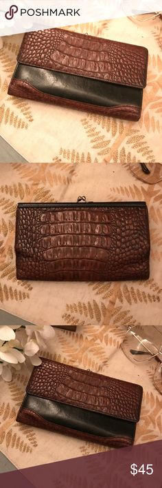 Gorgeous Brahmin Wallet Great condition Brahmin wallet very versatile. Hold checks, cash, cards, and coins. Classic black and brown. Brahmin Bags Wallets