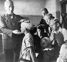 A German teacher lauds his students for their perfect Aryan or Nordic features .  [no credit]   A pinner's Jewish grandmother had this happen to her in Germany before the war. My grandma was a strawberry blonde, blue eyed little girl. When the Nazi Substitute teacher came one day to measure the children. He called upon my grandma, who went to the front of the class. Then he measured her and proclaimed her to be a perfect aryan. The whole class laughed and he was pretty upset.