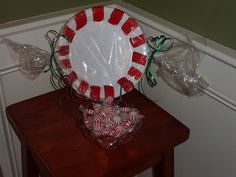 Easy peppermint candy decorations for Christmas that the kids could make. I could put this outside or hanging from our tree.