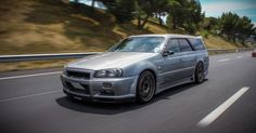 This would be my JDM family ride.  Nissan Stagea RS2 with a Skyline GTR front end