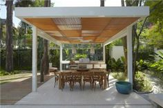 This free-standing patio cover blends metal and wood for a unique effect. Sections of alternating wood slats create a bold geometric pattern that's reminiscent of mid-century modern style. Photo credit: freshome.com For more patio cover design ideas, visit: http://www.landscapingnetwork.com/pergolas/patio-cover-design.html