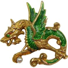 Art Nouveau 14K Emerald Seed Pearl Enamel Griffin/Dragon Brooch This Gorgeous Art Nouveau griffin/dragon Brooch is Beautifully crafted in 14K Solid