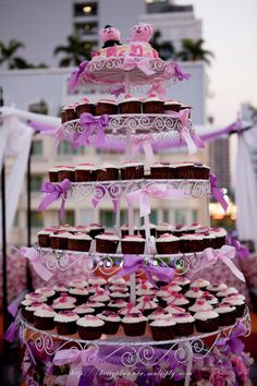 My Cupcake stand decorated with Pink & Violet Ribbon Bows... With my customized caketop :o)