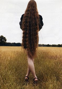 beautiful long hair! love it but my goal is to have it to my lower back. its gonna be so hard to not put heat on it and make it look good at the same time. wish me luck ); haha
