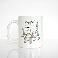 A mug with a kitty who is obviously a French expert.