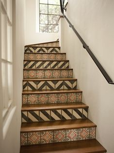 Painted stairs to look like tile.